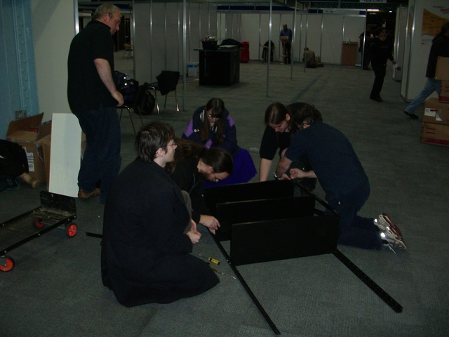 How many geeks does it take to disassemble some shelves?