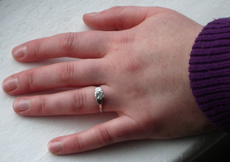 Kathy's hand with engagement ring